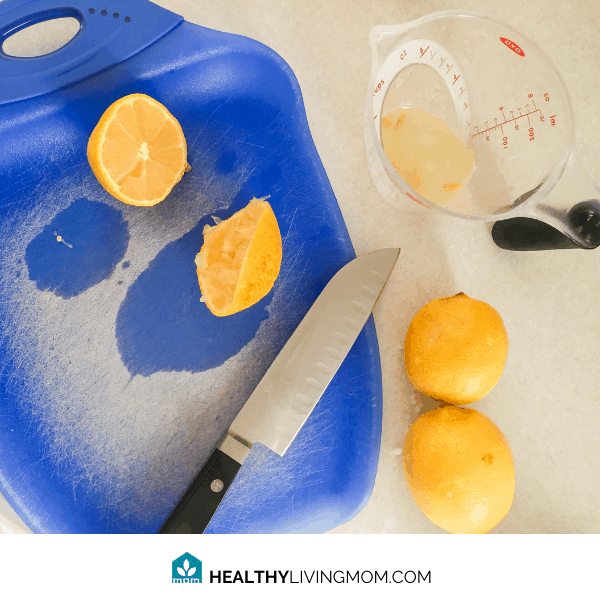 Lemon Sugar Scrub - Step 2 - Cut your lemon in half and squeeze the juice into another container that easily pours.